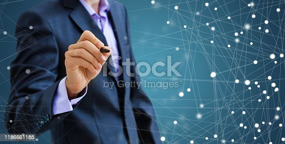 509469434istockphoto Businessman draw growth graph and progress of business and analyzing financial and investment data ,business planning and strategy on blue background. 1186661185