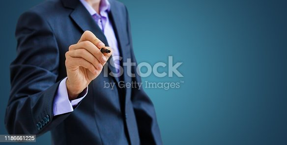509469434istockphoto Businessman draw growth graph and progress of business and analyzing financial and investment data ,business planning and strategy on blue background. 1186661225