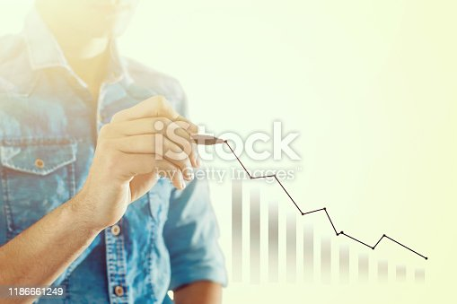 509469434istockphoto Businessman draw growth graph and progress of business and analyzing financial and investment data ,business planning and strategy on blue background. 1186661249