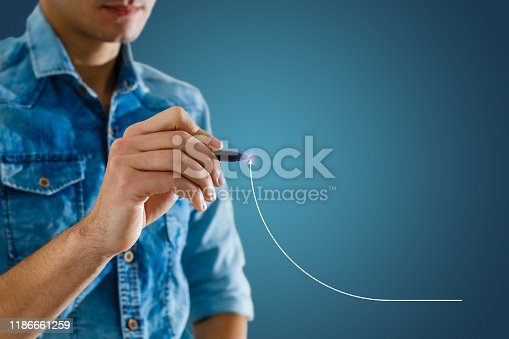 509469434istockphoto Businessman draw growth graph and progress of business and analyzing financial and investment data ,business planning and strategy on blue background. 1186661259