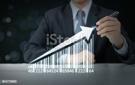 istock Businessman draw increasing graph with barcode, business growth 854276900
