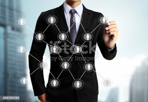 522382893istockphoto A businessman drawing a social network on the screen 459283283
