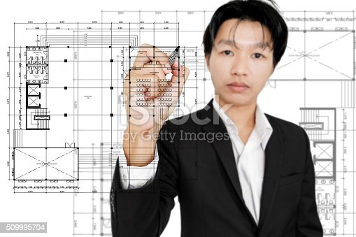 istock Businessman drawing architecture layout plan, on white background 509995704