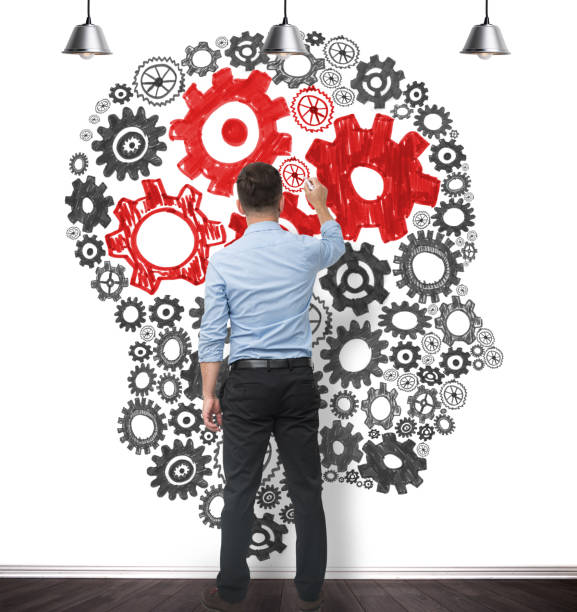 businessman drawing brain stock photo