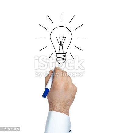 istock Businessman drawing bulb 174974507