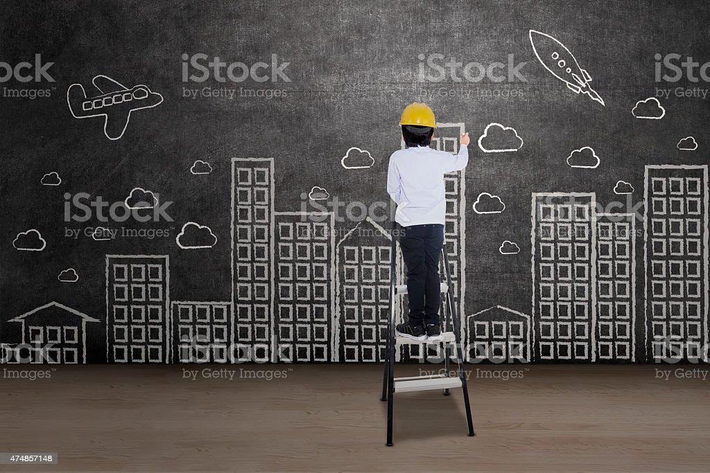 Businessman drawing cityscape stock photo