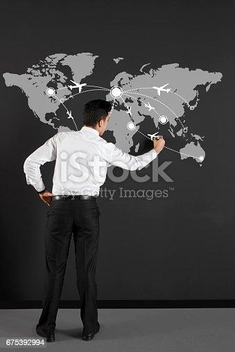 istock businessman drawing flight board 675392994