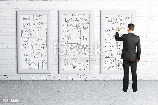 istock businessman drawing  formulas 503488882