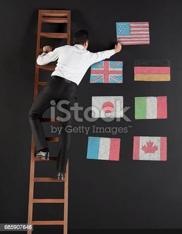 istock businessman drawing G7 countries flags 685907646