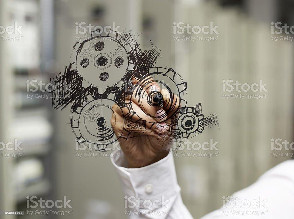 Businessman drawing gear wheel. royalty-free stock photo