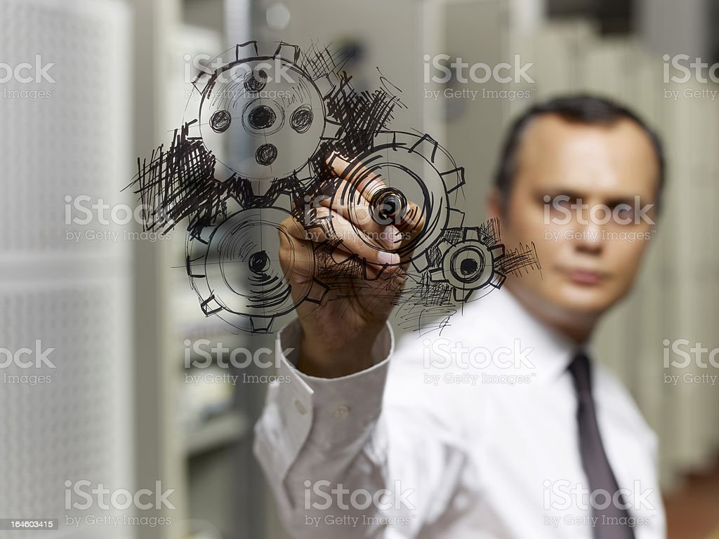 Businessman drawing gear wheel. royalty-free stock photo