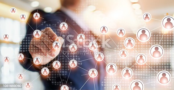 istock Businessman drawing global structure networking and data exchanges customer connection on office background. 1051659260