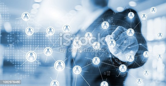 istock Businessman drawing global structure networking and data exchanges customer connection on office background, blue tone. 1052976480