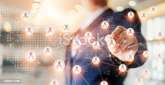 istock Businessman drawing global structure networking and data exchanges customer connection on office background 1069541396