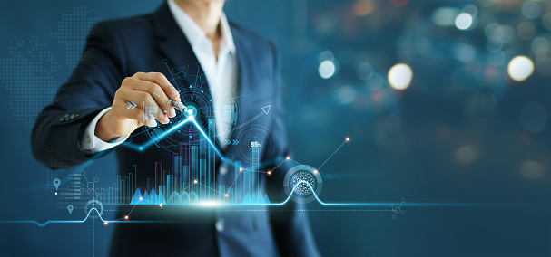 istock Businessman drawing growth graph chart sales and data economic on global structure networking connection. 1165049242