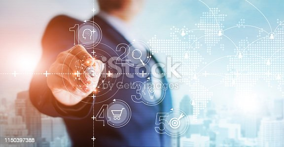istock Businessman drawing network connection and moving digital data with a pen on hologram screen, innovative, digital marketing and business future technology. 1150397388