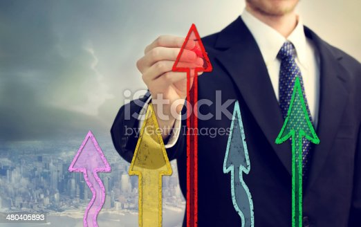 Businessman drawing the colorful rising arrows shapes