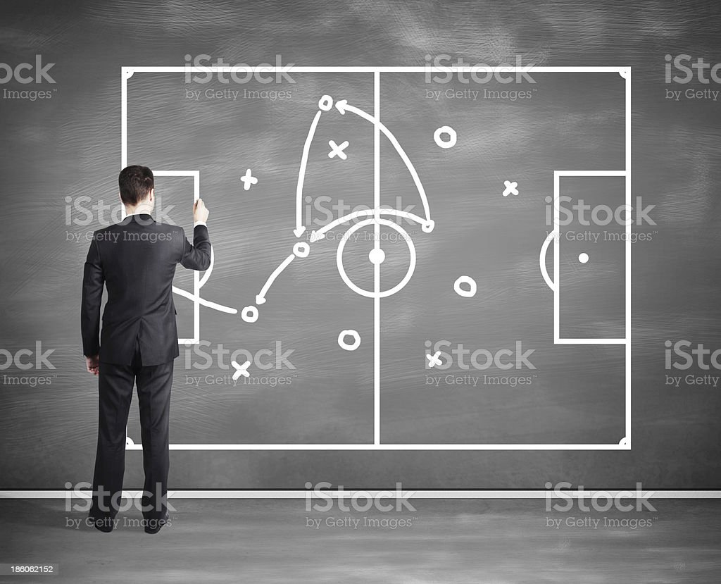 businessman drawing tactic scheme royalty-free stock photo