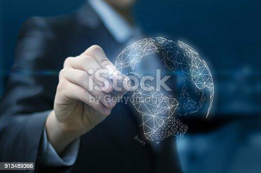 917493152istockphoto Businessman draws a global business network. 913489366
