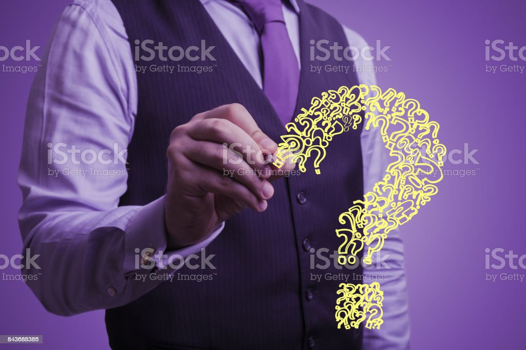 businessman draws a question stock photo