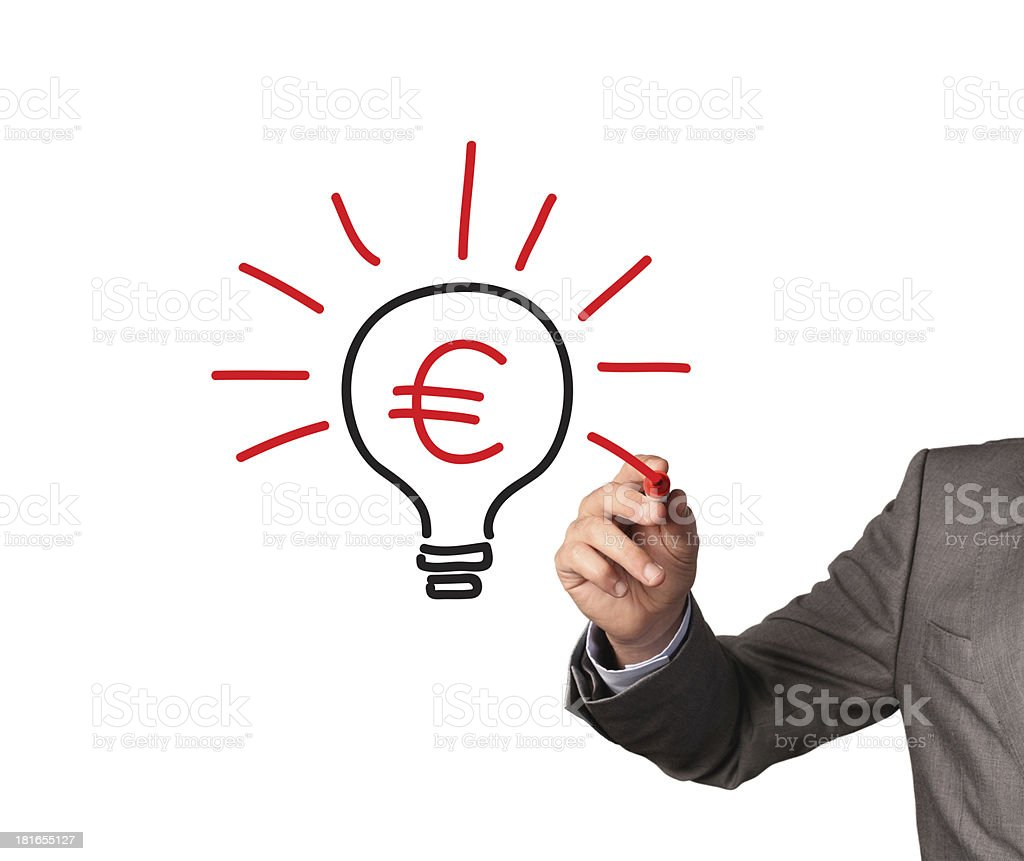 Businessman draws Euro sign inside symbolic lightbulb stock photo