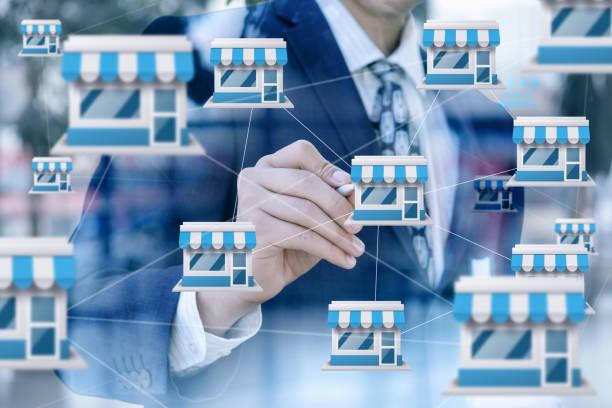 Businessman draws franchise marketing system . stock photo