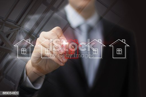 istock Businessman draws house for sale . 889054820