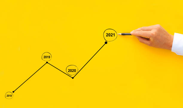 Businessman draws the growth chart in 2021 compared to previous years. Development business and growing concept. stock photo