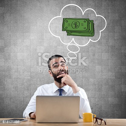 istock Businessman dreaming about growth of income 613121466
