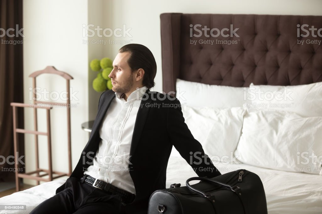 Businessman dreaming about leisure or vacation stock photo