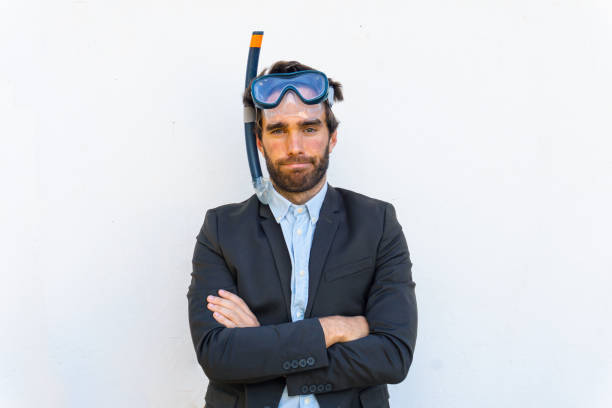 Businessman dreams with beach holidays. Snorkeling goggles. Dream, vacancies, beach concept. stock photo