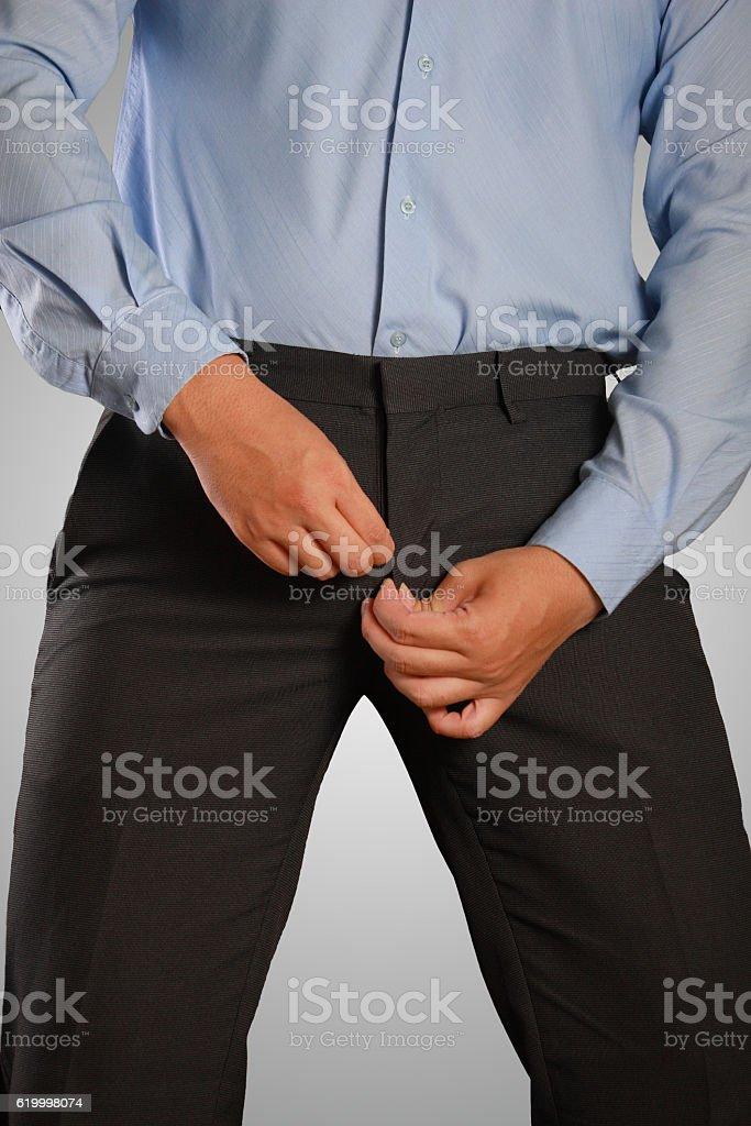 Businessman Dressing, Pulling His Pants Zipper stock photo