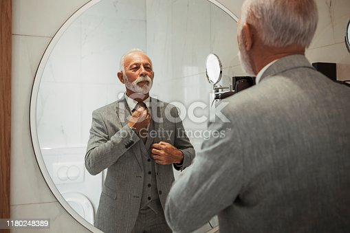 Businessman dressing up in bathroom