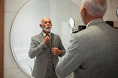 Businessman dressing up in bathroom