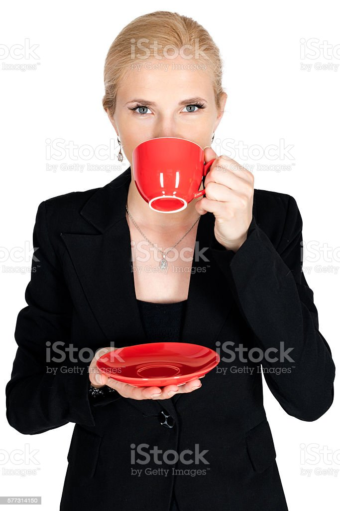 Businessman drink coffee from red teacup have open eyes stock photo