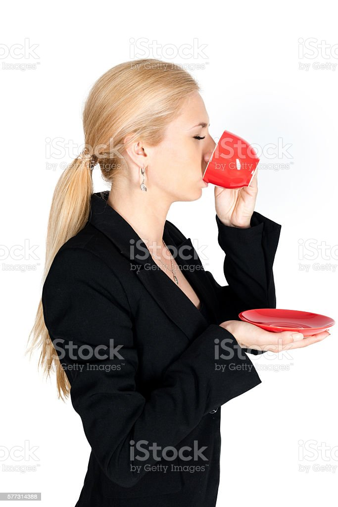 Businessman drink coffee from red teacup one side body stock photo