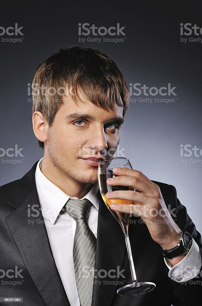 Businessman drinking a glass of white wine royalty-free stock photo