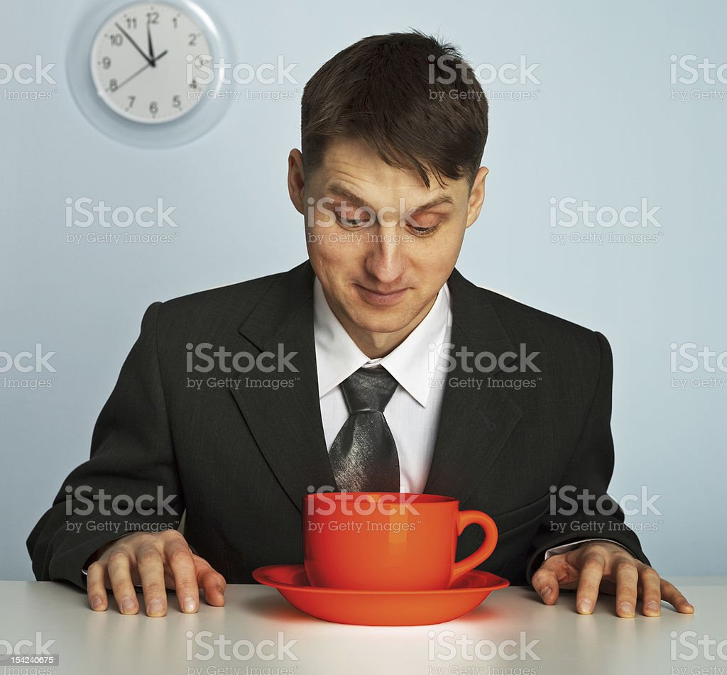 Businessman drinking a very strong and  hot coffee royalty-free stock photo