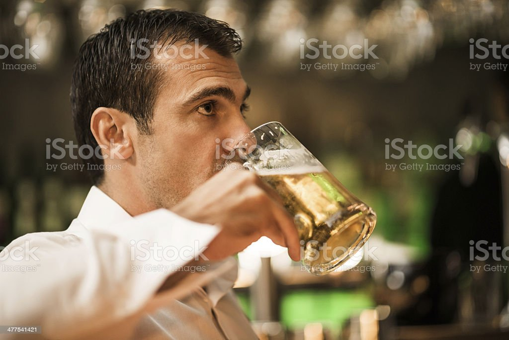 Businessman drinking beer. royalty-free stock photo