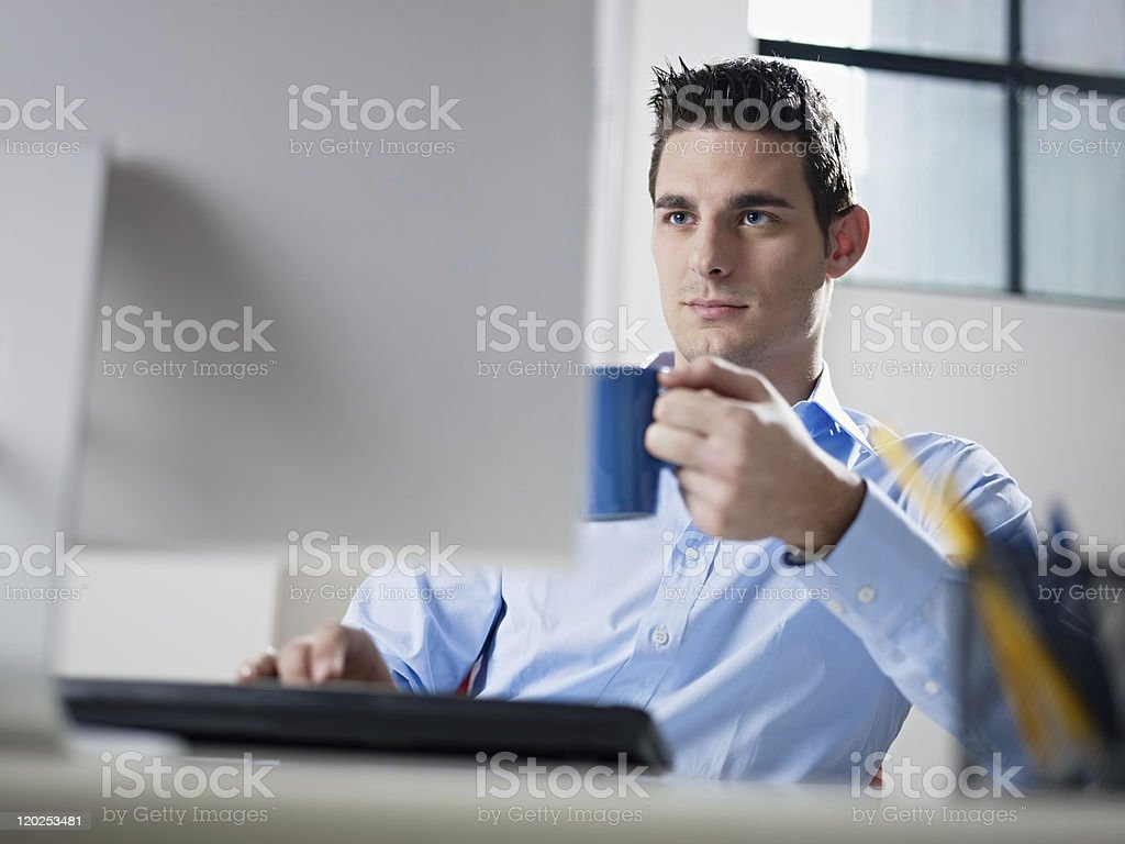 businessman drinking coffee in office royalty-free stock photo