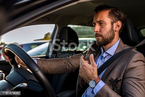 849721378istockphoto Businessman driving a car 1181579052