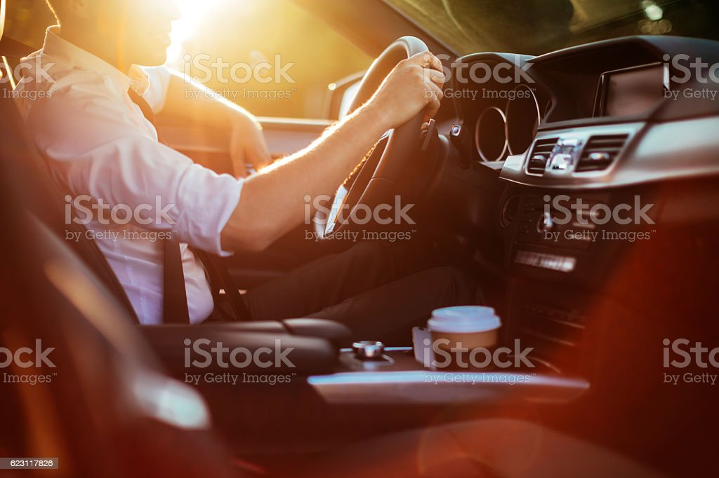 Businessman driving a car​​​ foto