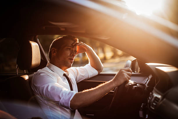 Businessman driving a car Close up photo of a businessman driving a car traffic jam stock pictures, royalty-free photos & images