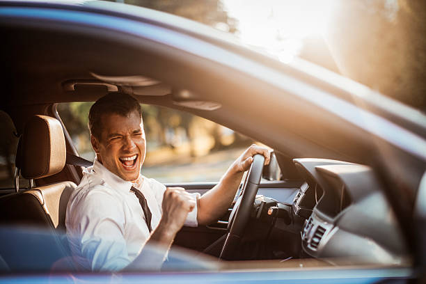 Businessman driving a car Close up photo of a businessman driving a car singing stock pictures, royalty-free photos & images