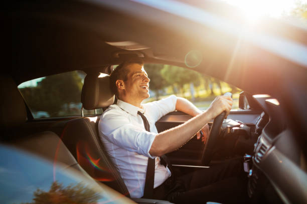 businessman driving a car - driver stock photos and pictures