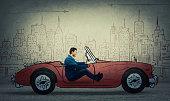 businessman driving a drawn race car