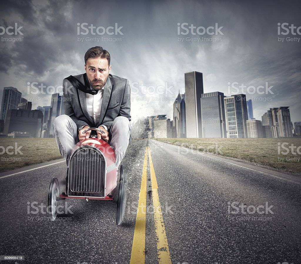 Businessman driving a fast car stock photo