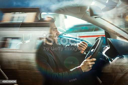 istock Businessman driving car 498399696
