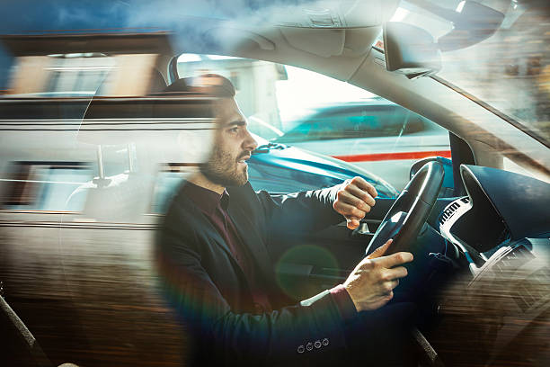 Businessman driving car stock photo