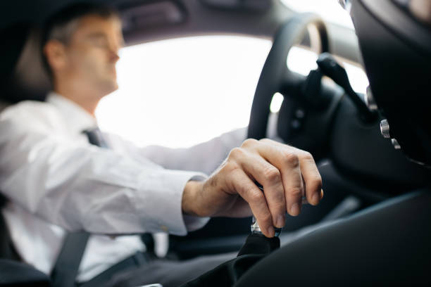 Businessman driving to work Businessman driving to work, hand shifting the gear stick gearshift stock pictures, royalty-free photos & images